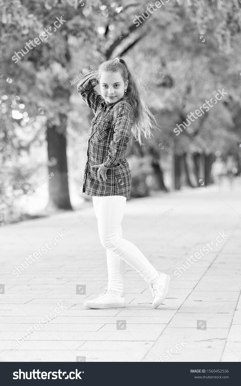 Hairstyles to wear on windy days. Windproof hairstyles. Girl little cute child enjoy walk on windy day nature background. Feeling cozy and comfortable on windy day. Deal with long hair on windy day. #1569452536