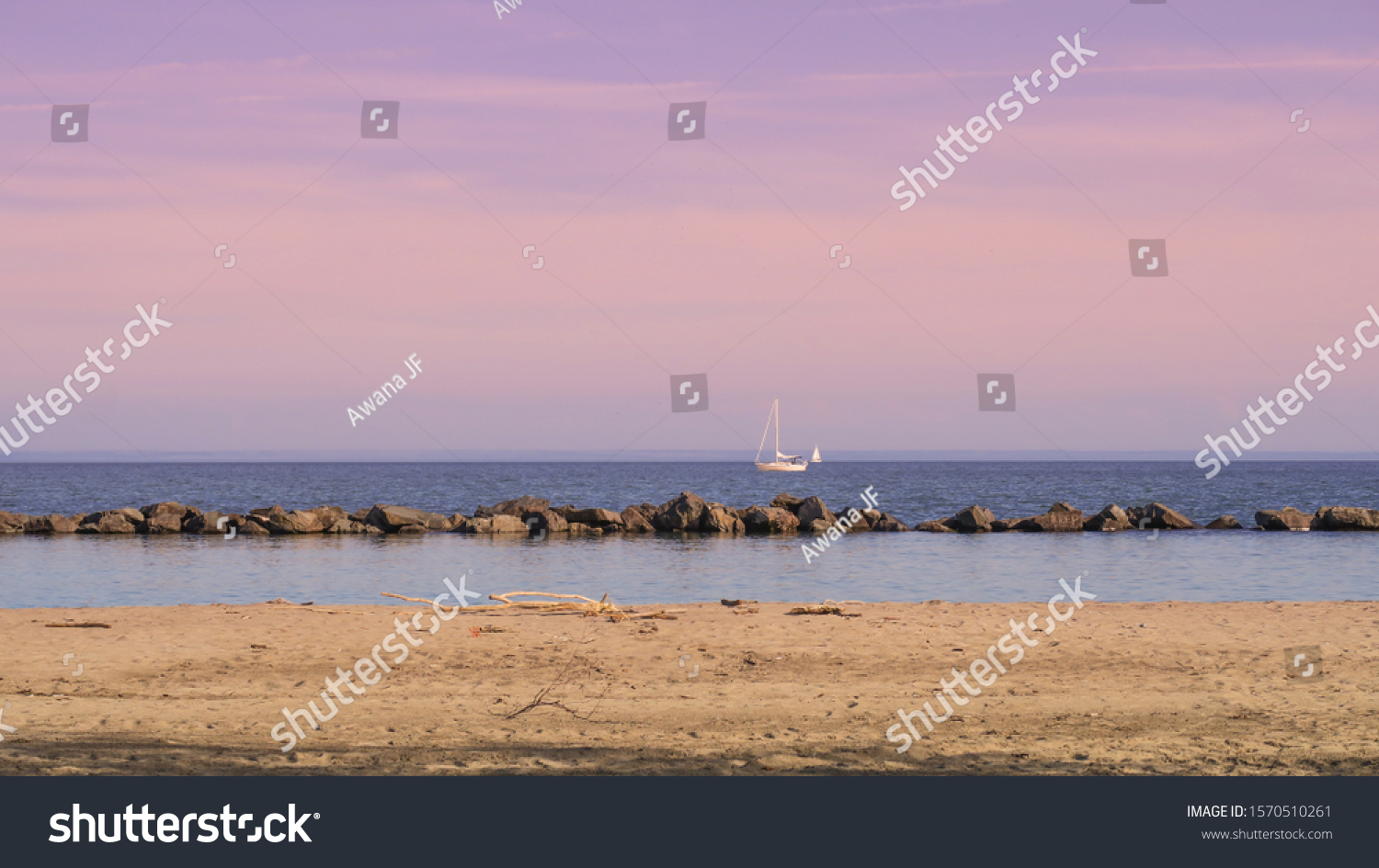 stock-photo-sand-beach-with-a-boat-in-th