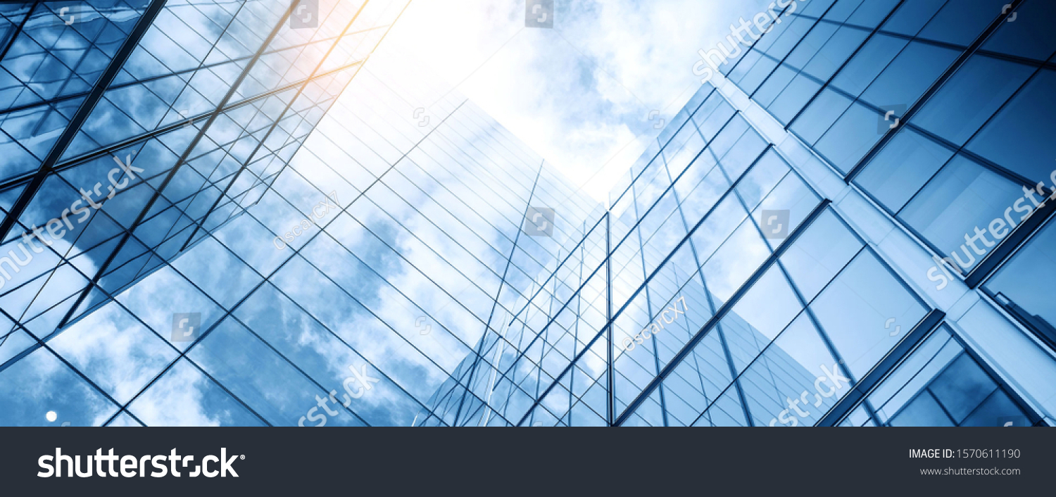 glass buildings with cloudy blue sky background #1570611190