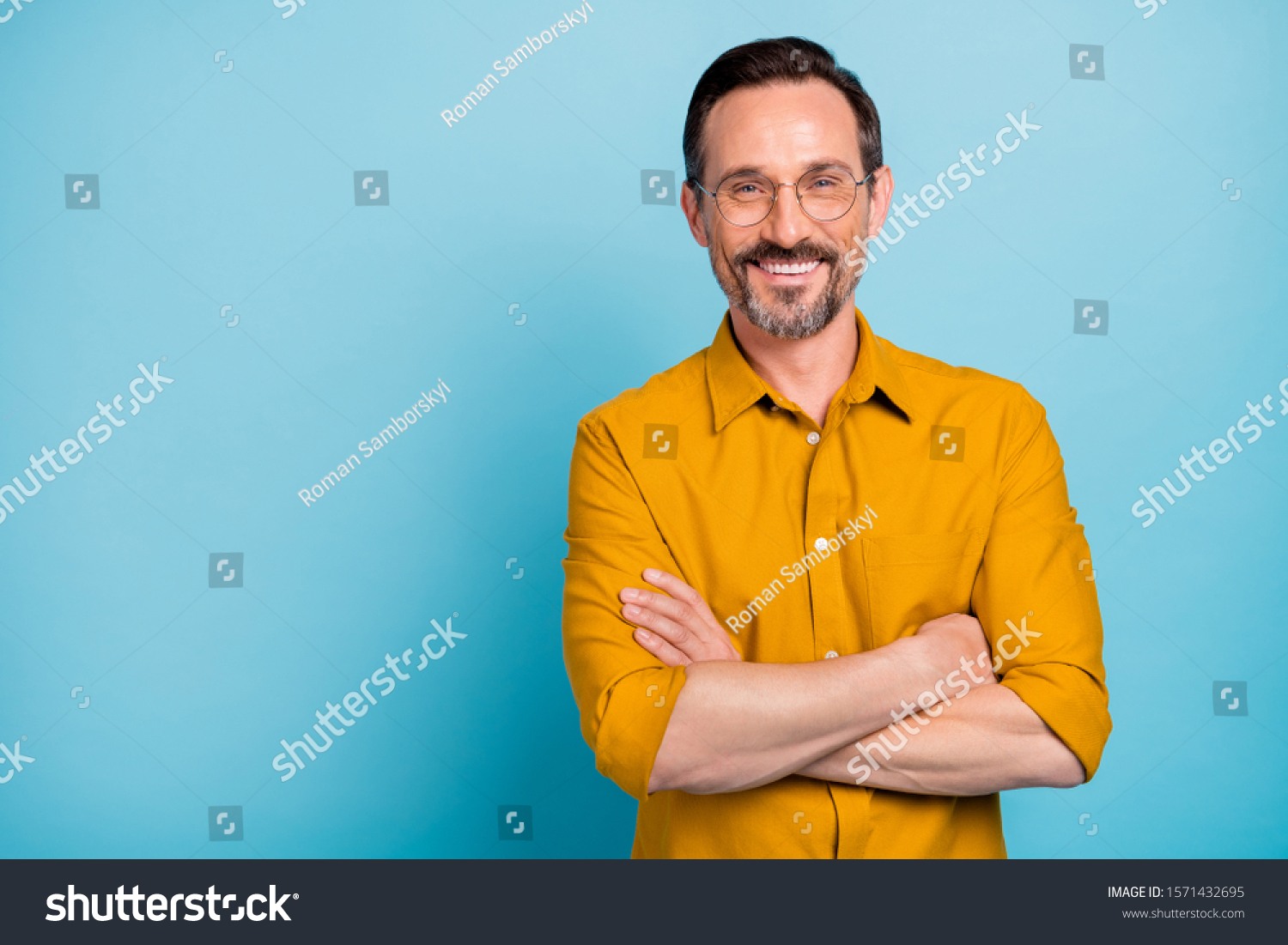 Portrait of charming mature man true boss feel content emotions wear yellow shirt isolated over blue color background #1571432695
