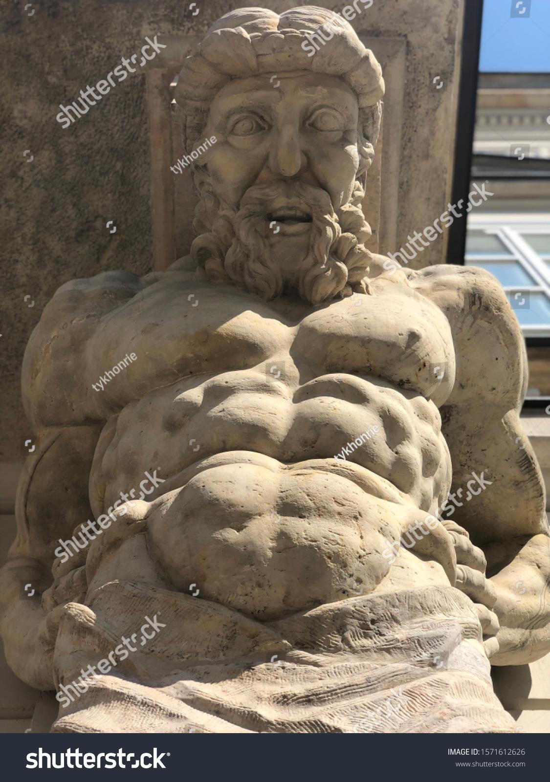 stock-photo-stone-statue-of-greek-man-sc