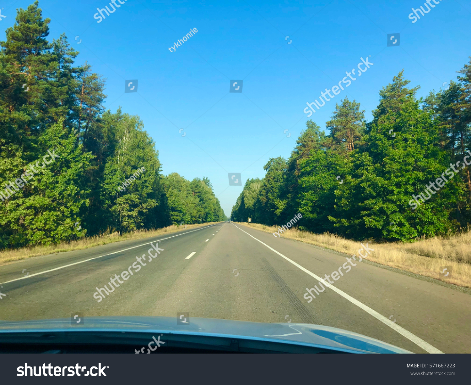stock-photo-asphalt-highway-with-green-f