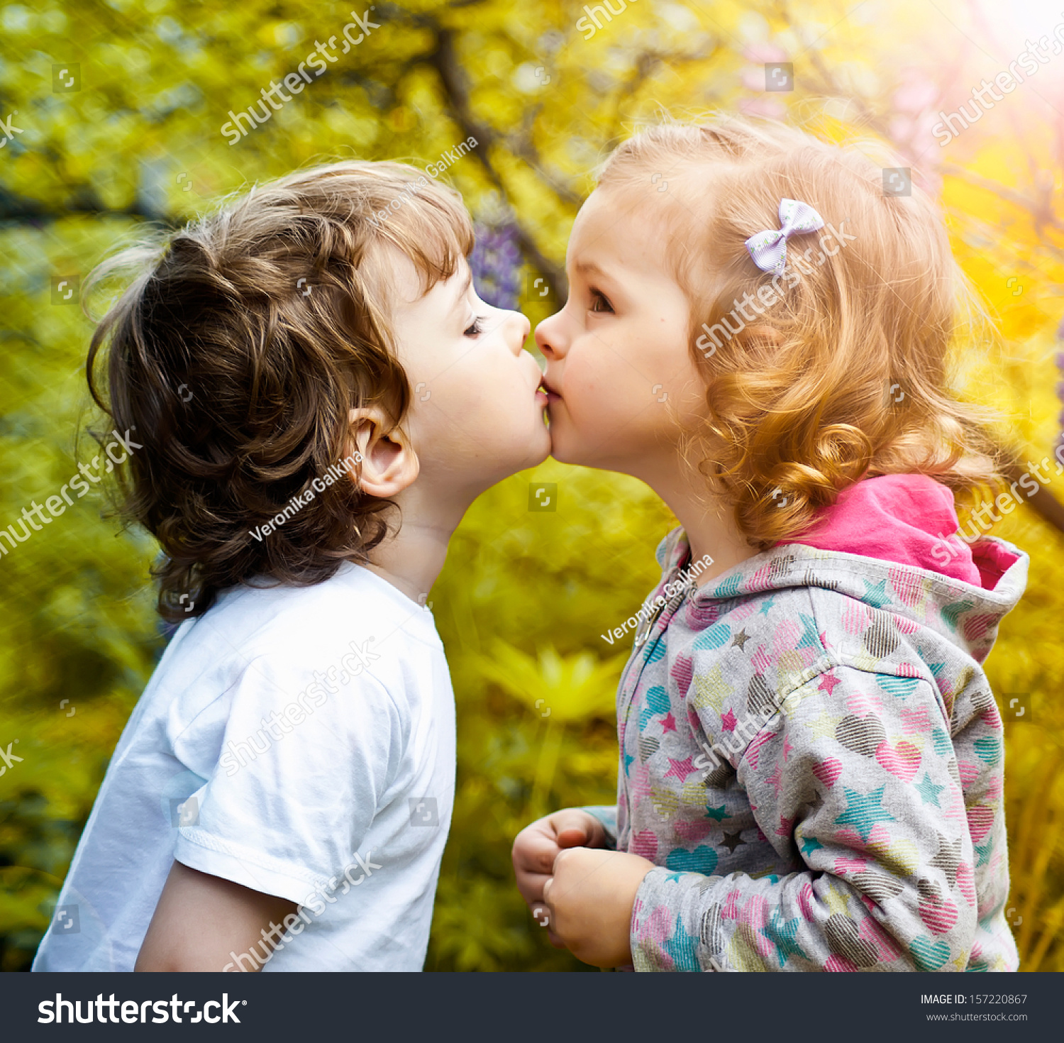 Little Boy Kissing Girl Stock Photo 157220867 - Shutterstock-7782