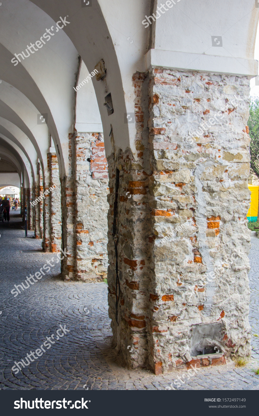 stock-photo-line-of-old-pillars-on-stree