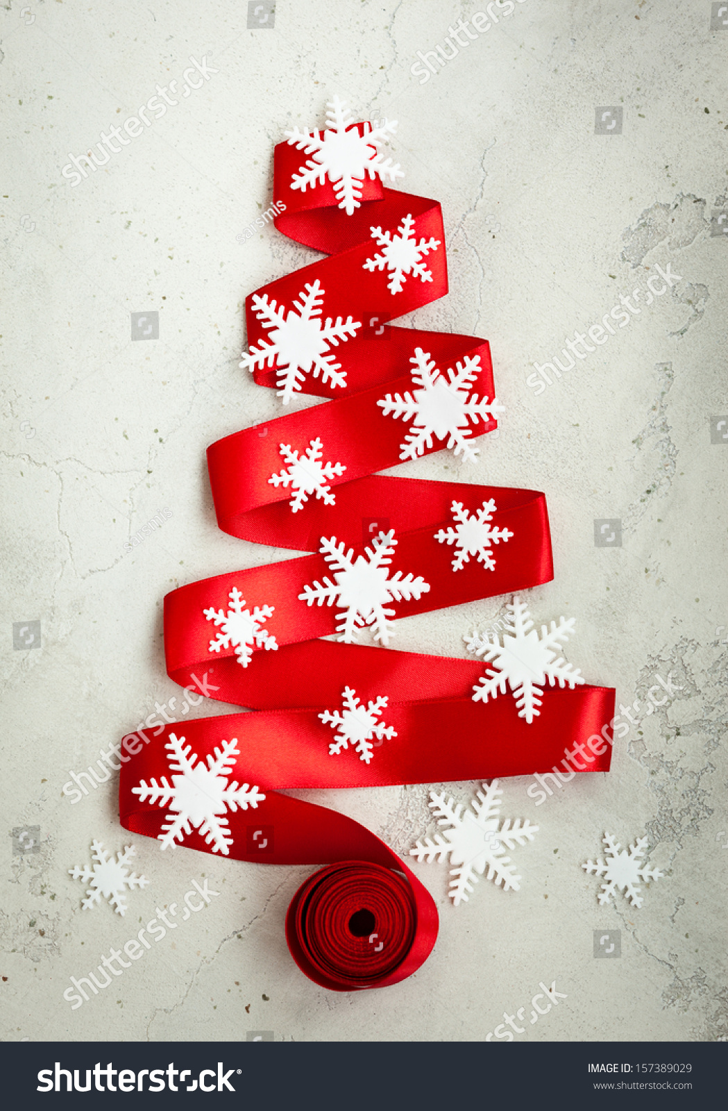 Red ribbon christmas tree decor on stock photo 157389029 for Red ribbon around tree