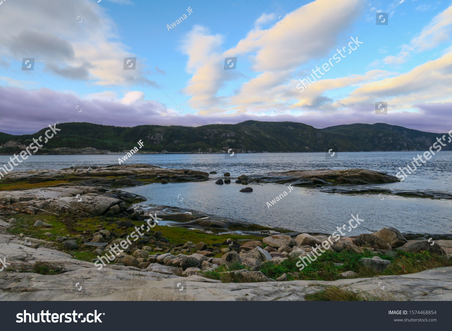 stock-photo-sunset-over-the-shore-of-the