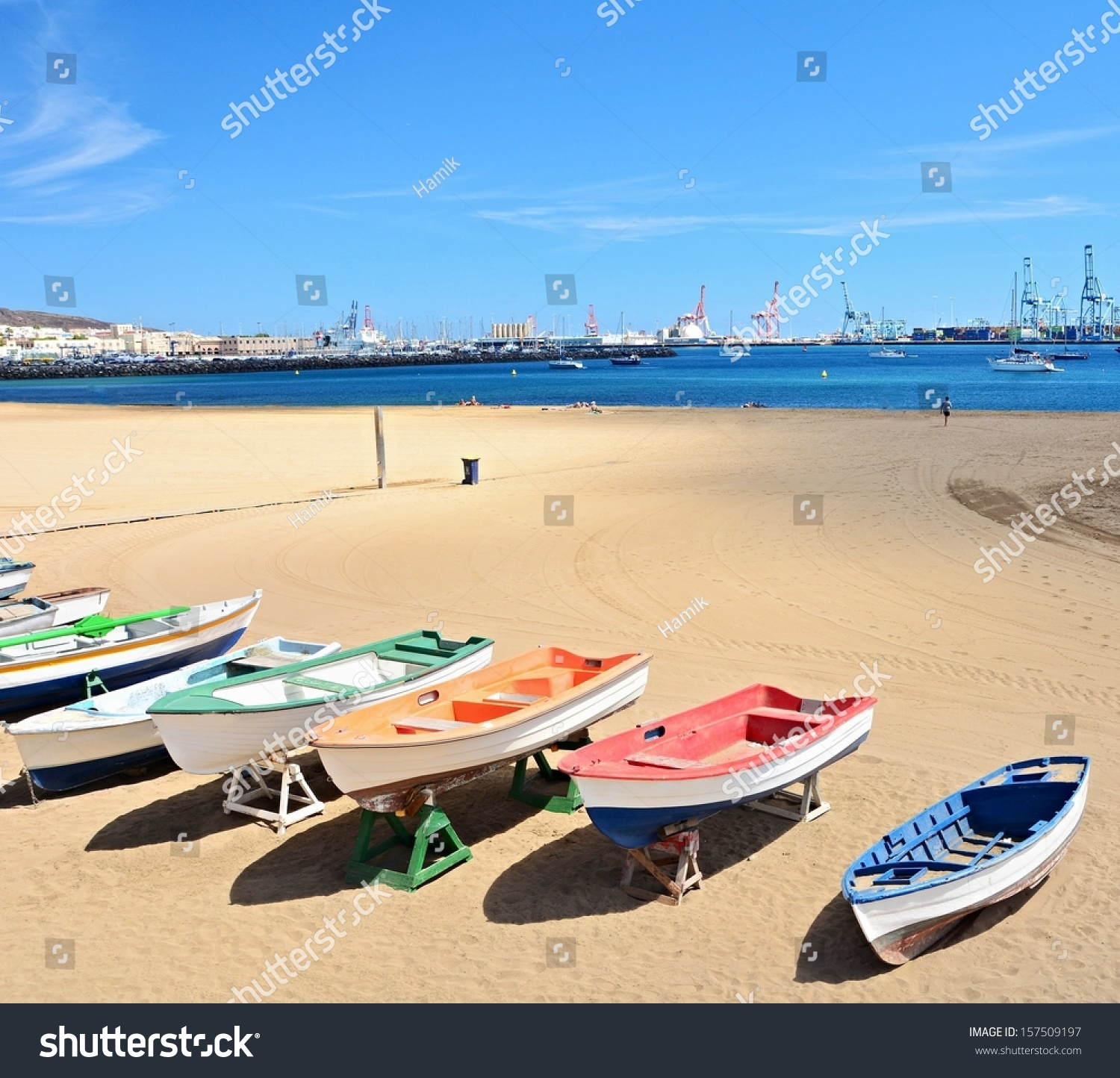 Beach with old boats and big port at las palmas gran canaria stock photo 157509197 shutterstock - Port of las palmas gran canaria ...