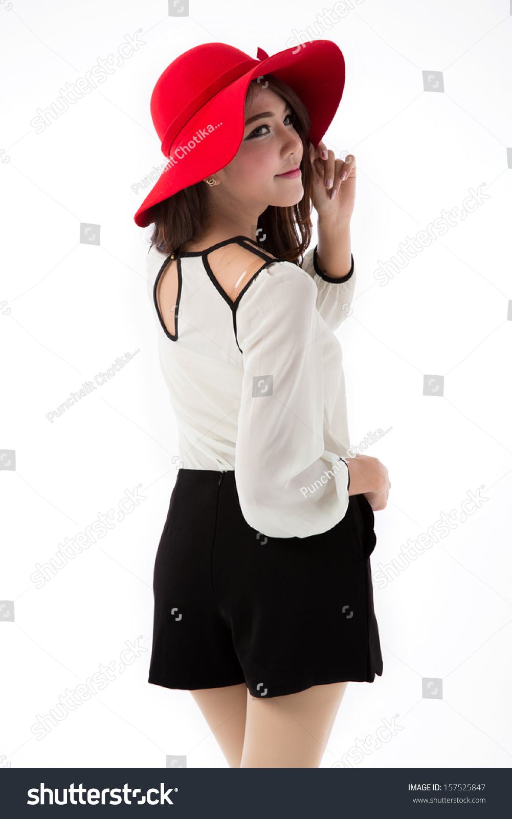 ab2743ea2540 Beautiful young Asian woman posing in white blouse and black skirt with red  had isolated on white background. - Image