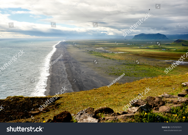 Vik, Iceland, coastline. Iceland black sand. Ocean and black sand coast. White waves. South Iceland landscape. Black, white, blue landscape.