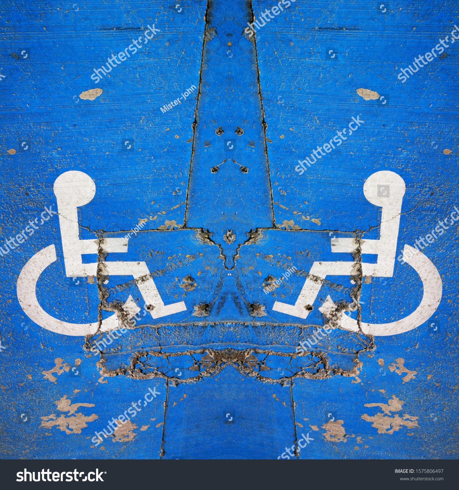 traditional universal icon for disabled access and parking zone white on blue painted surface #1575806497