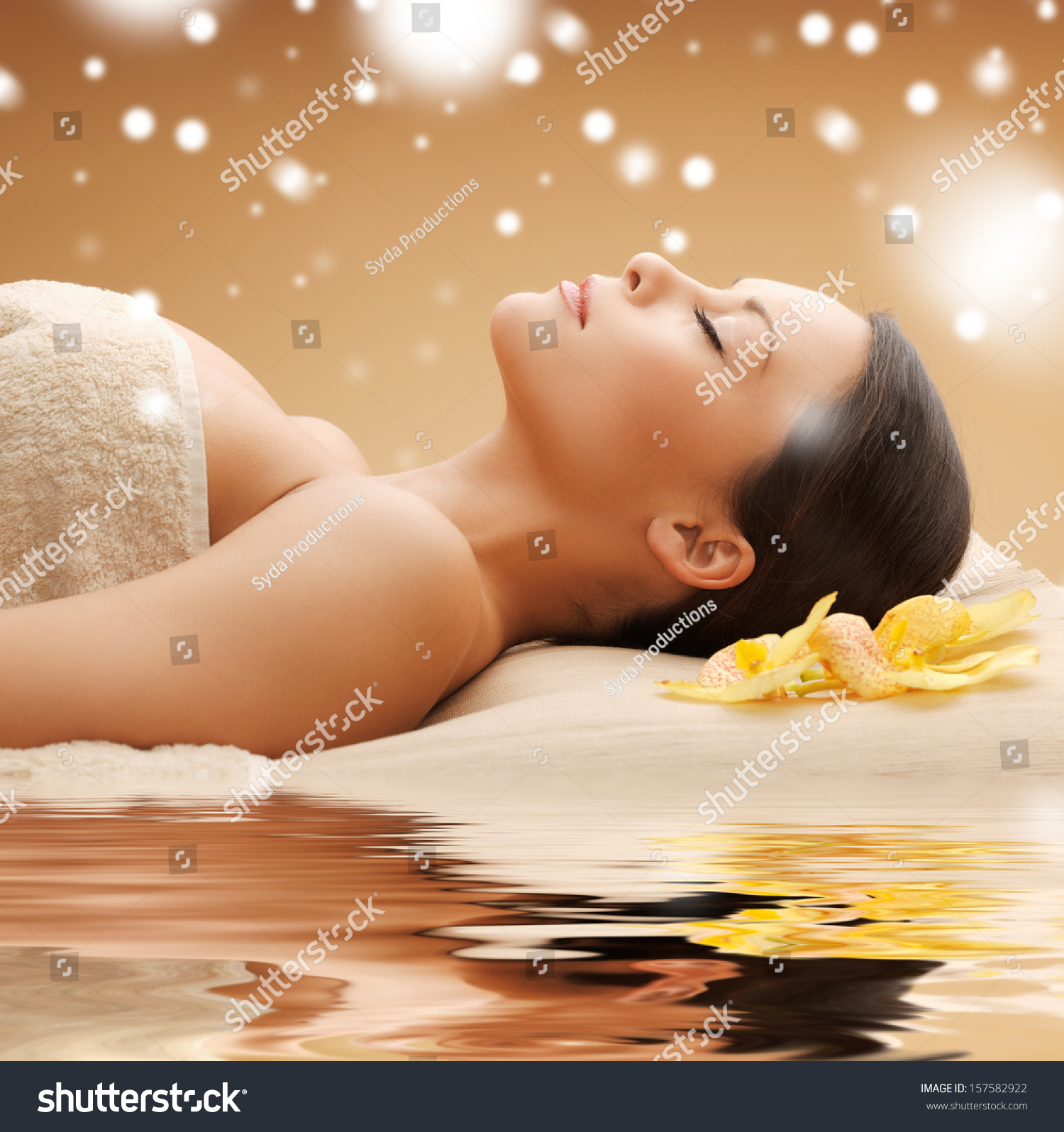health and beauty concept woman in spa salon lying on the massage desk stock photo 157582922. Black Bedroom Furniture Sets. Home Design Ideas