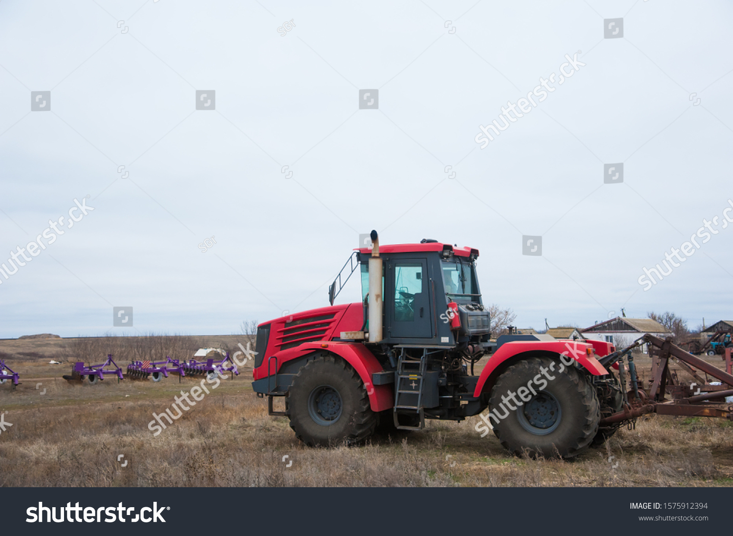 Farm machinery on a farm in the winter #1575912394