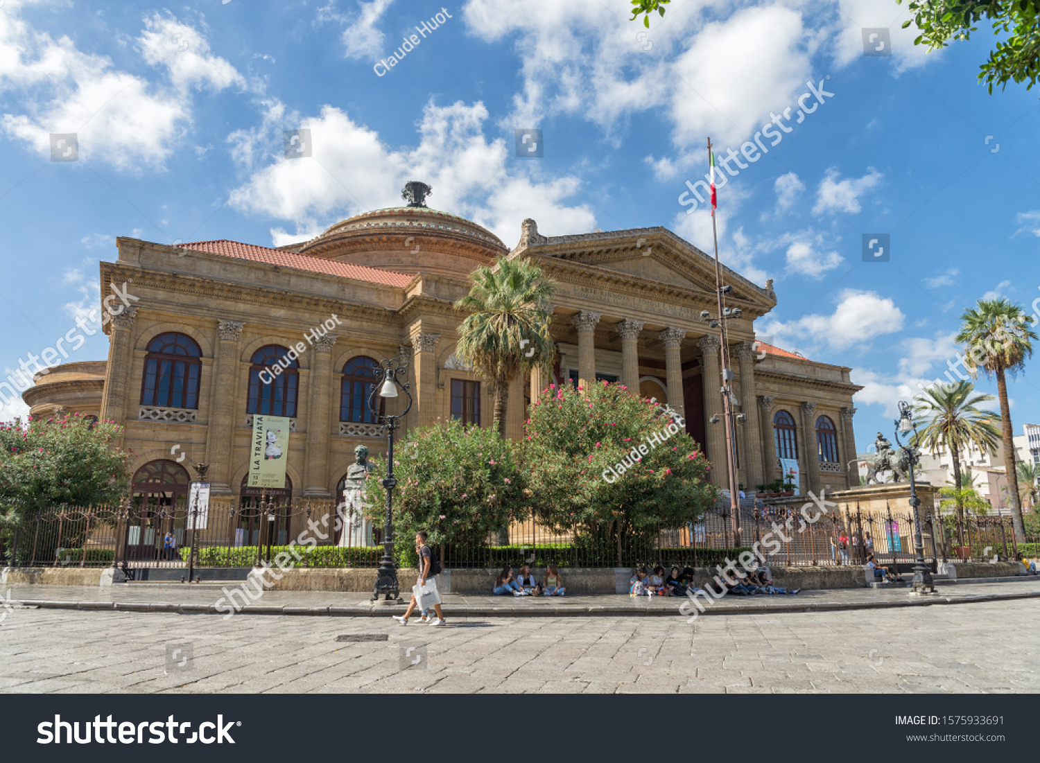 "PALERMO, SICILY, ITALY - SEPTEMBER 27, 2019: The Massimo Theater on ""Piazza Verdi"" in Palermo. It is the largest theater and opera house in Italy. It is a landmark popular with tourists."