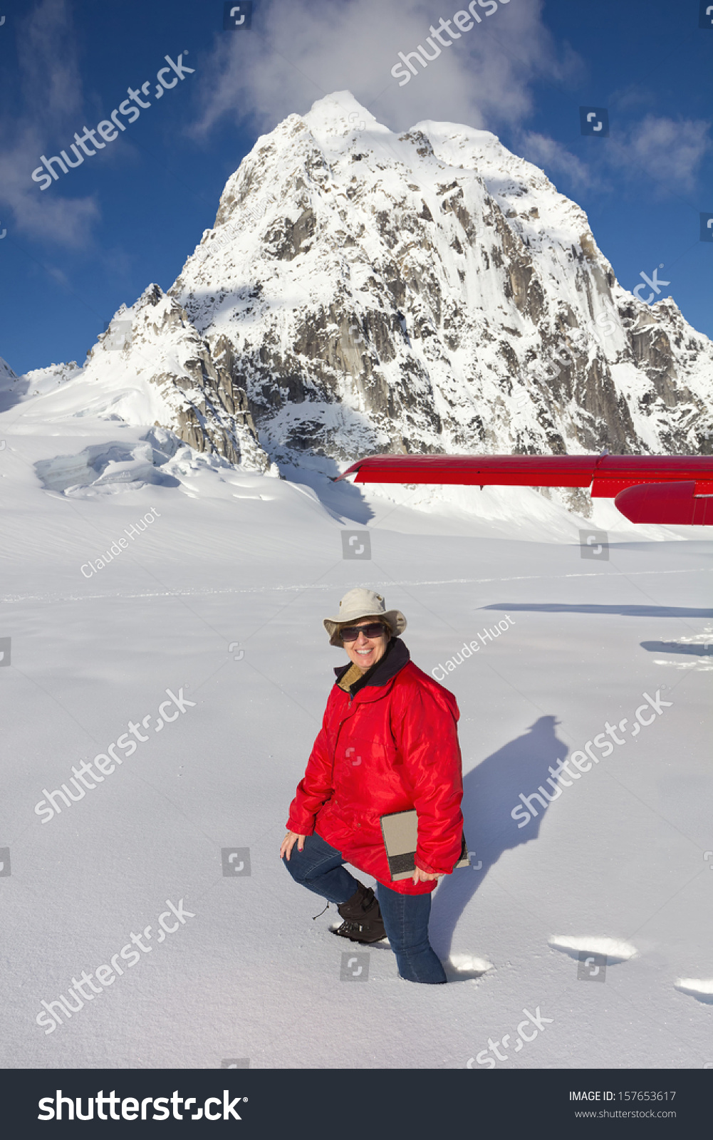 Tourist Walking in Deep Snow after Plane Landing on Pika Glacier in Denali National Park, Alaska near Mount McKinley