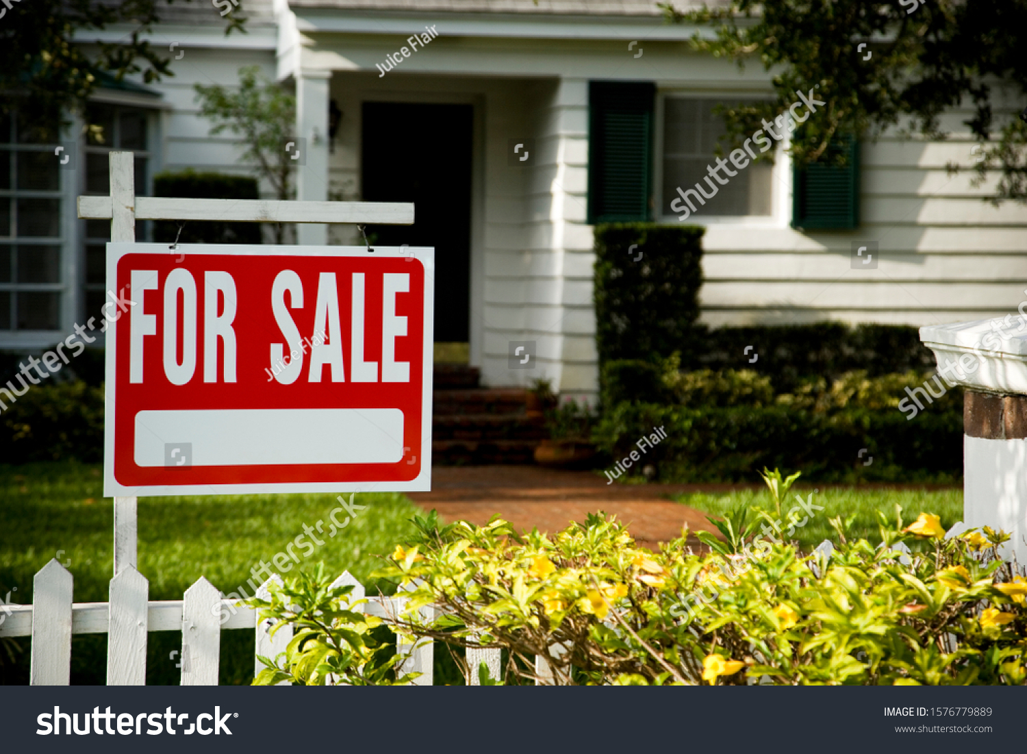 For sale sign outside a family house #1576779889