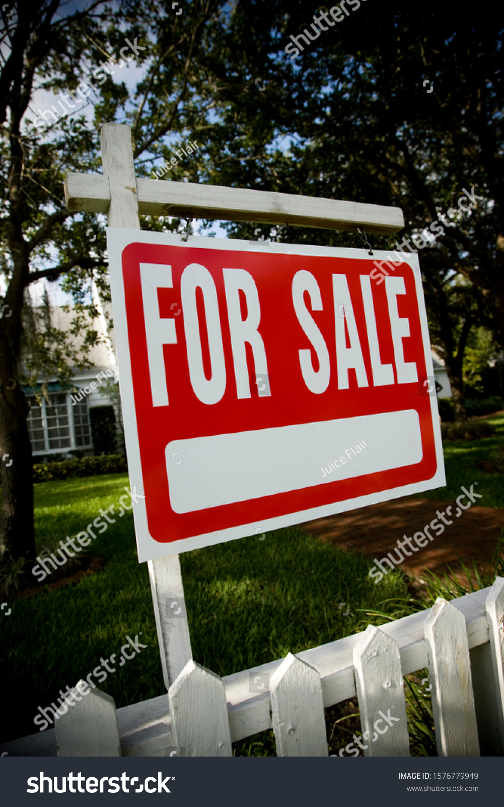 For sale sign outside a family house #1576779949