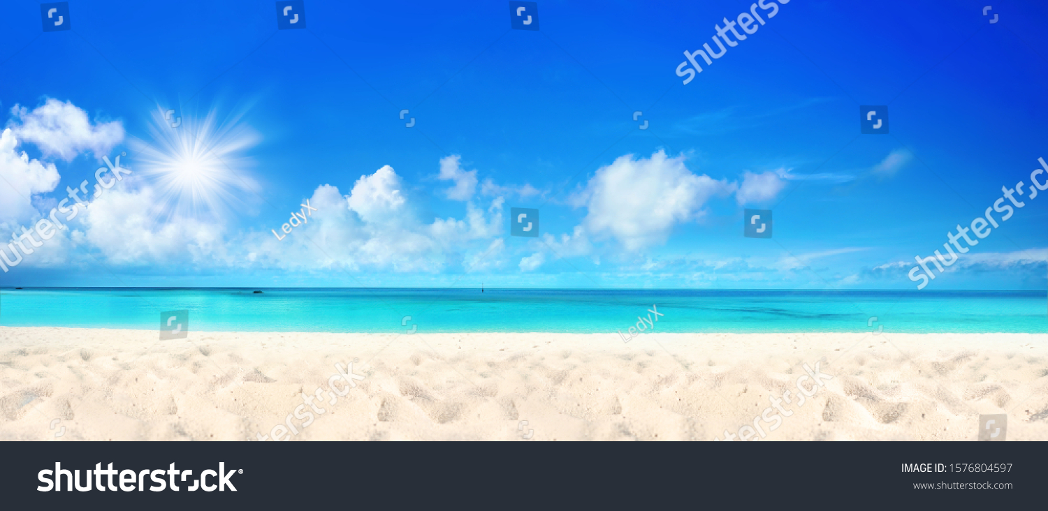 Beautiful beach with white sand, turquoise ocean water and blue sky with clouds in sunny day. Panoramic view. Natural background for summer vacation