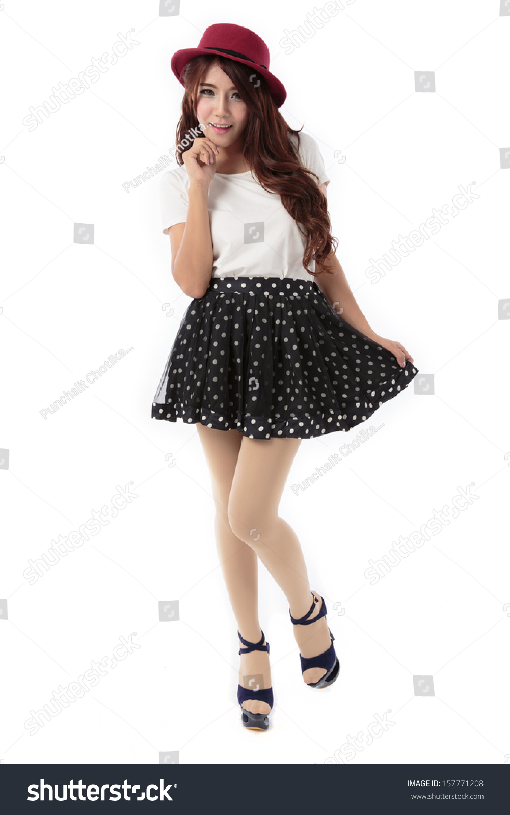 0ce4bd569d9b6b Beautiful young asian woman full body posing in dress with red hat, white  blouse and blue dotted skirt isolated on white background. - Image