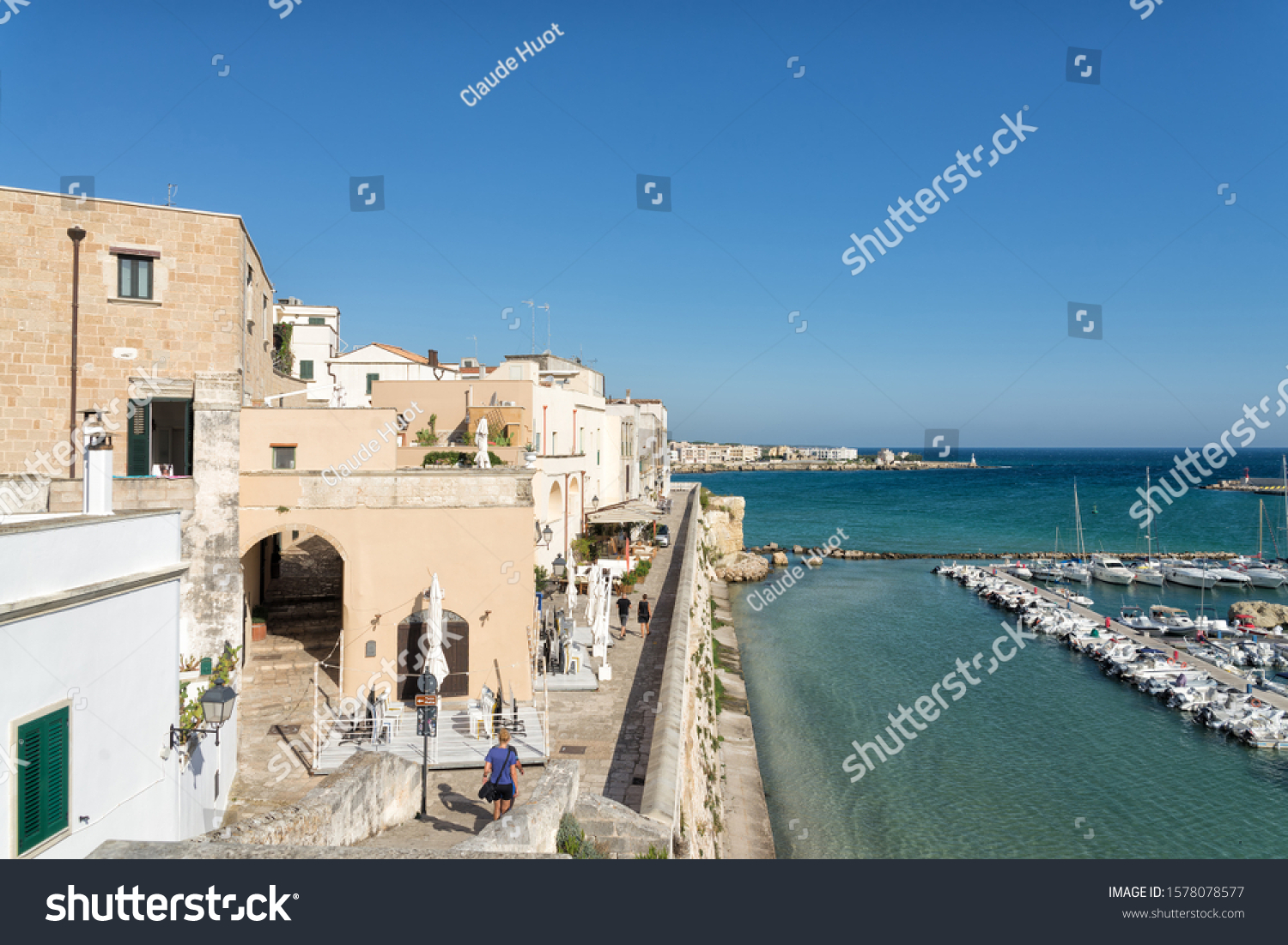 OTRANTO, APULIA, ITALY - SEPTEMBER 14, 2019: The seaside city of Otranto, with its architecture, sea-side promenades and restaurants, port for pleasure boats, make this town very popular for tourists.