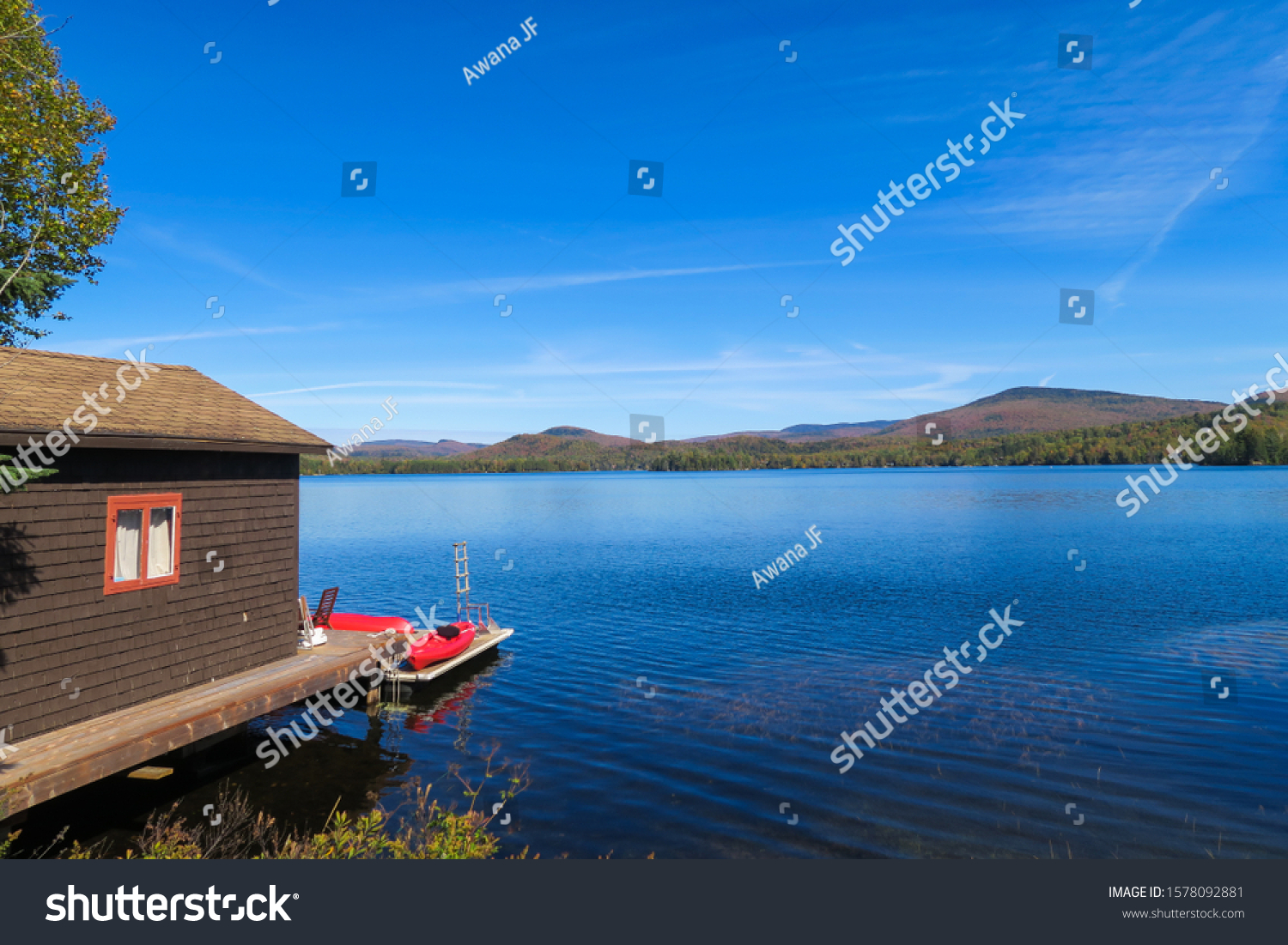 stock-photo-view-of-a-wooden-cottage-by-