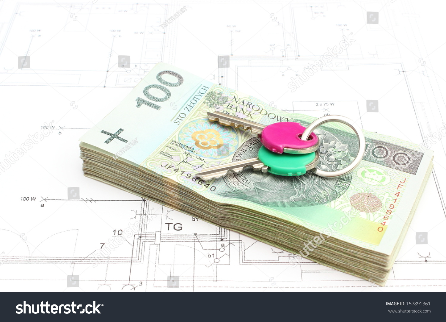 Money keys lying on construction drawing stock photo for How contractors make money