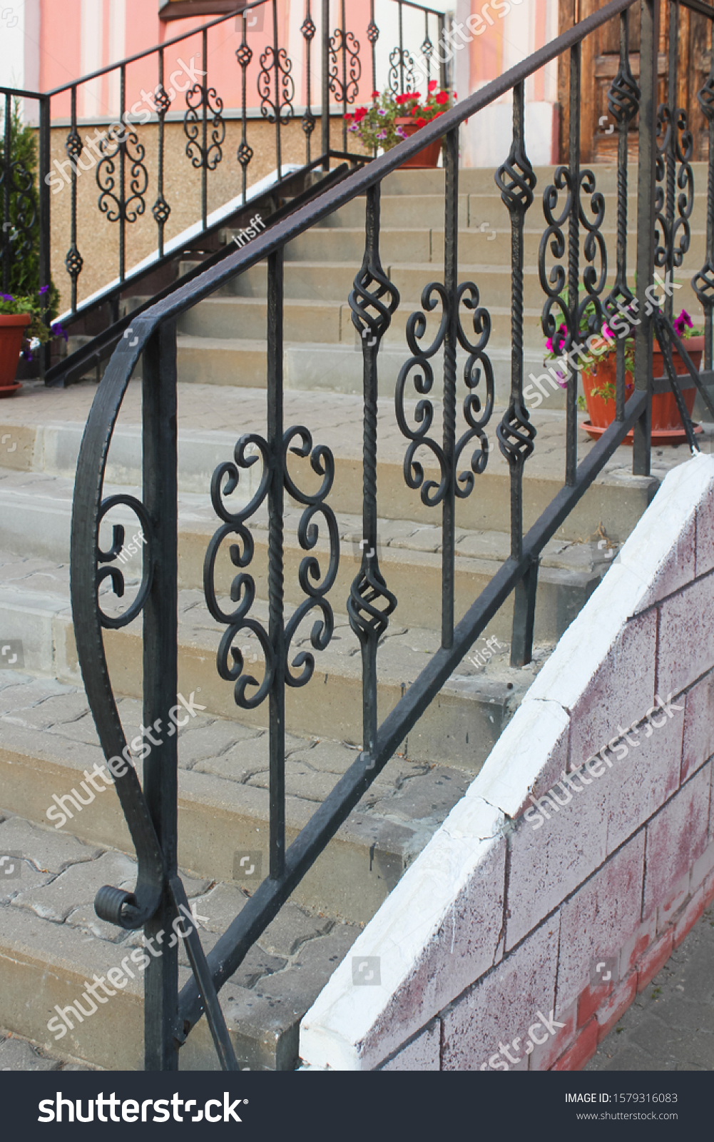 stock-photo-black-wrought-iron-railing-w
