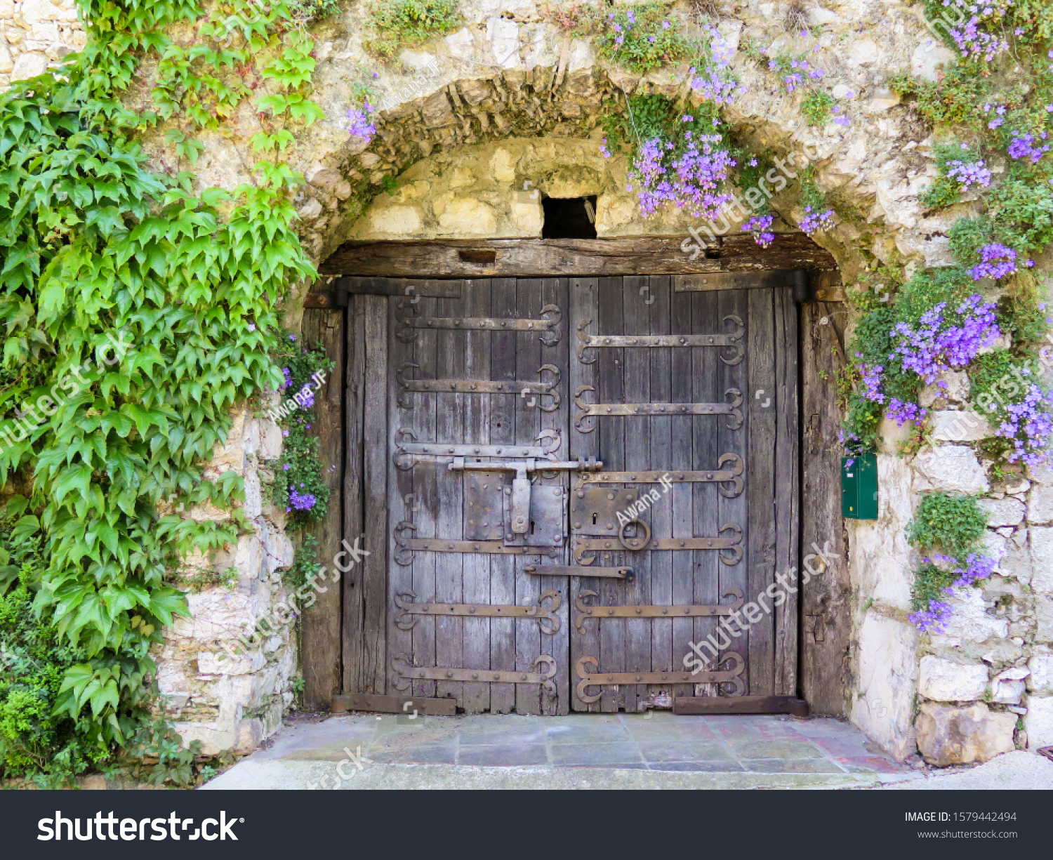 stock-photo-ancient-wooden-doors-of-an-o