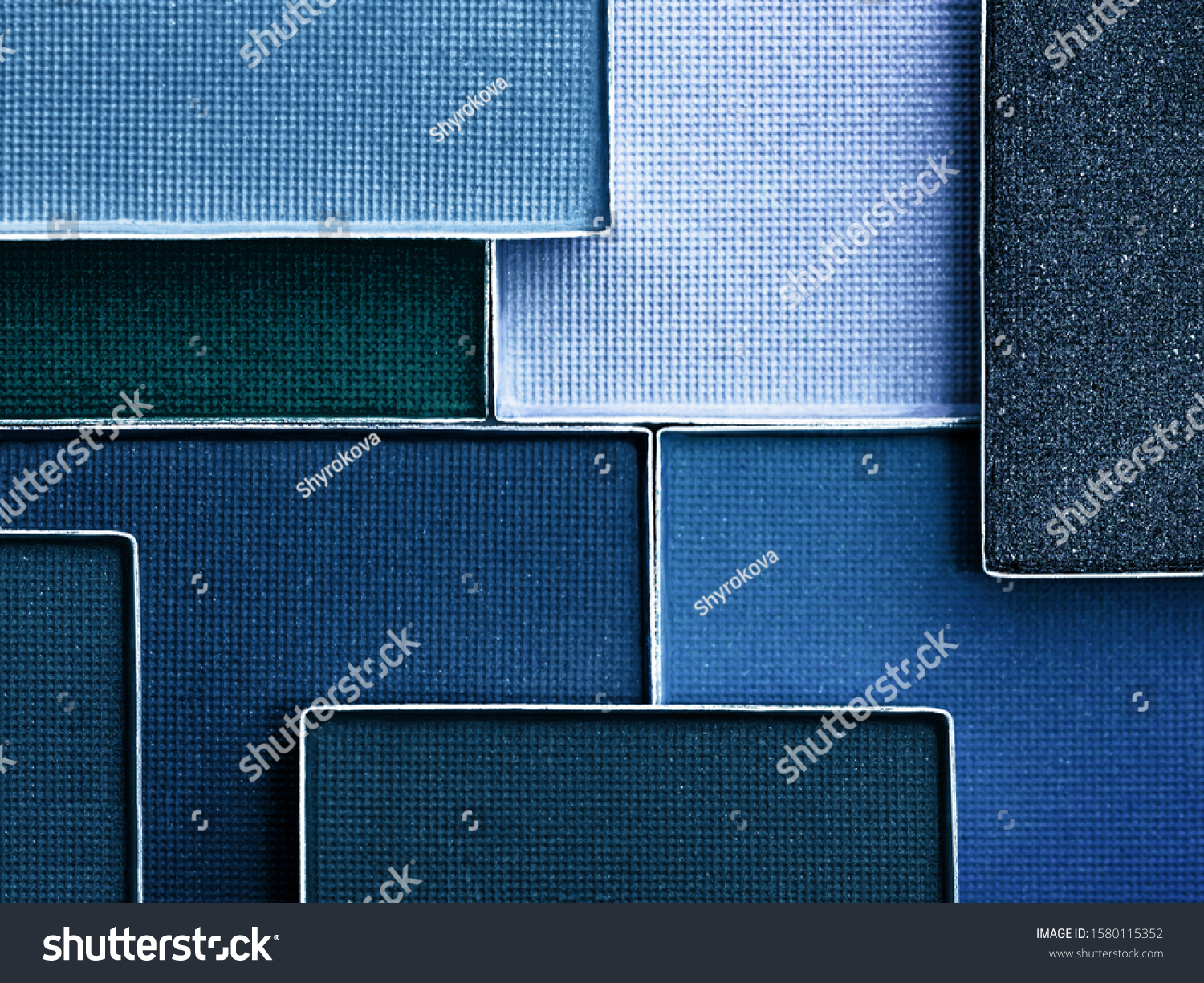 Classic blue palette of eye makeup. Color of the year 2020. Classic blue background. Cosmetics products background in trendy color scheme. #1580115352