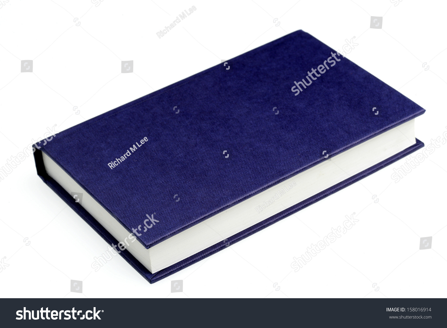 Blue Covered Book ~ Hard back blue covered book stock photo