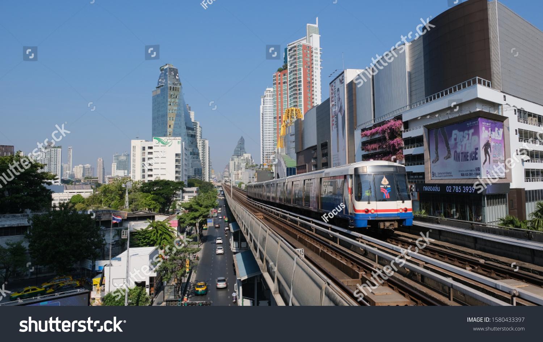 BANGKOK, THAILAND - DECEMBER 5, 2019: A Skytrain goes through the city on elevated tracks on Sukhumvit Road on December 5, 2019 in Thai capital Bangkok