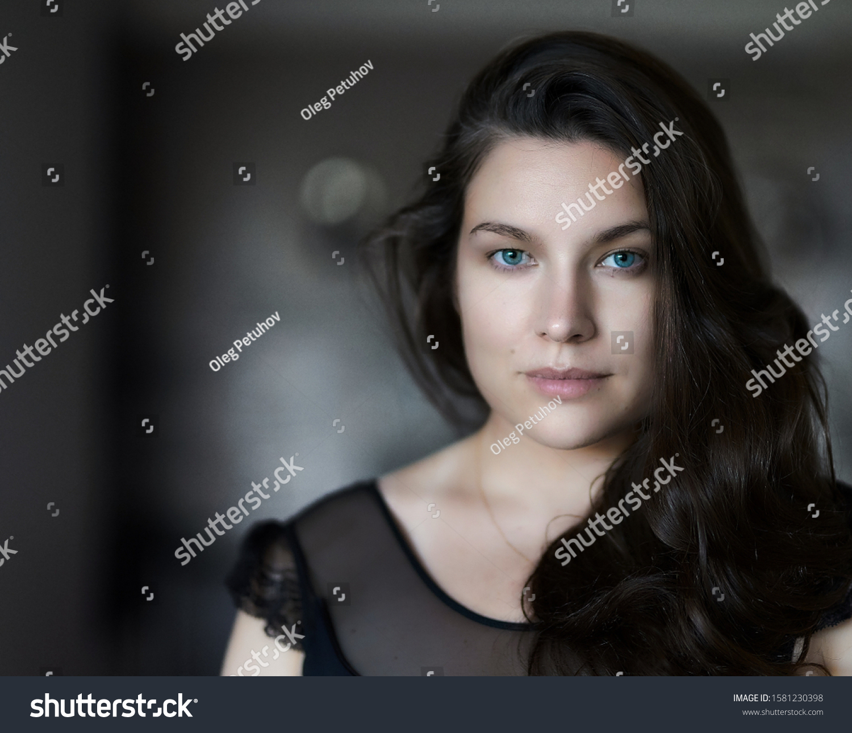 Portrait of pretty woman dark hair, blue eyes. Womans face. portrait of beautiful woman. portrait of young woman. #1581230398