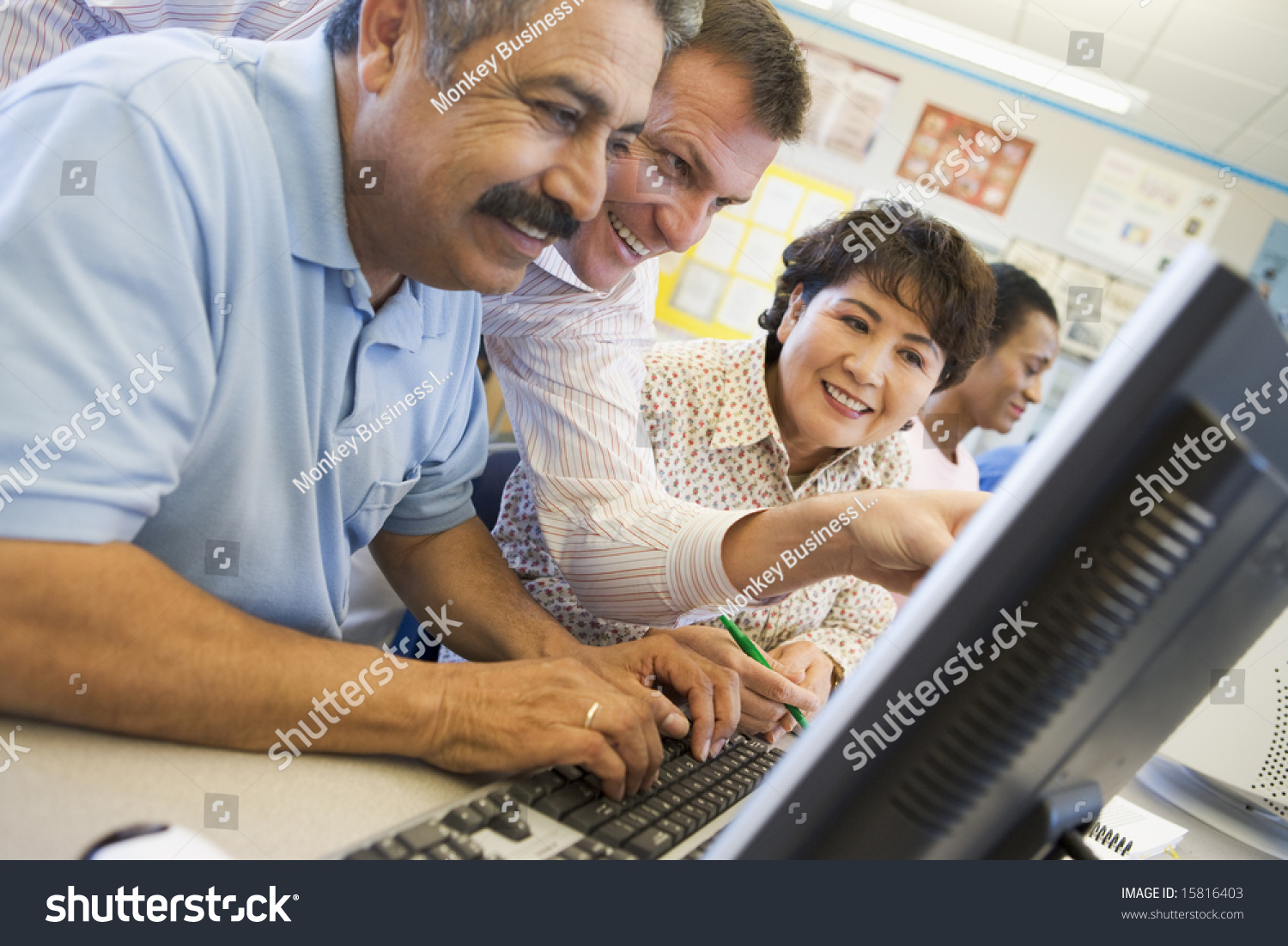 mature students learning computer skills stock photo  mature students learning computer skills preview save to a lightbox