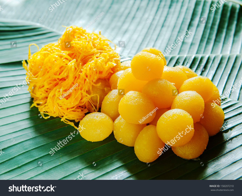 golden thai dessert on banana leaf stock photo 158207210. Black Bedroom Furniture Sets. Home Design Ideas