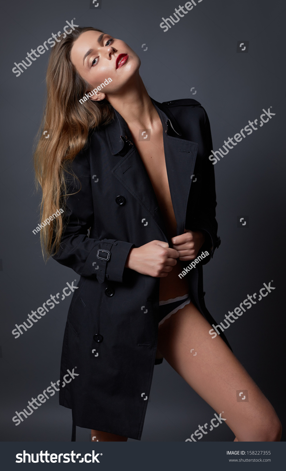 Sexy woman in trench coat