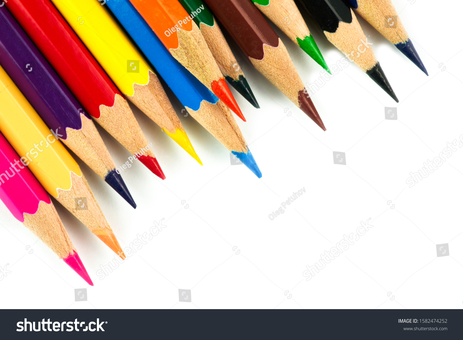 Colored pencils background. Color pencils on white background. #1582474252