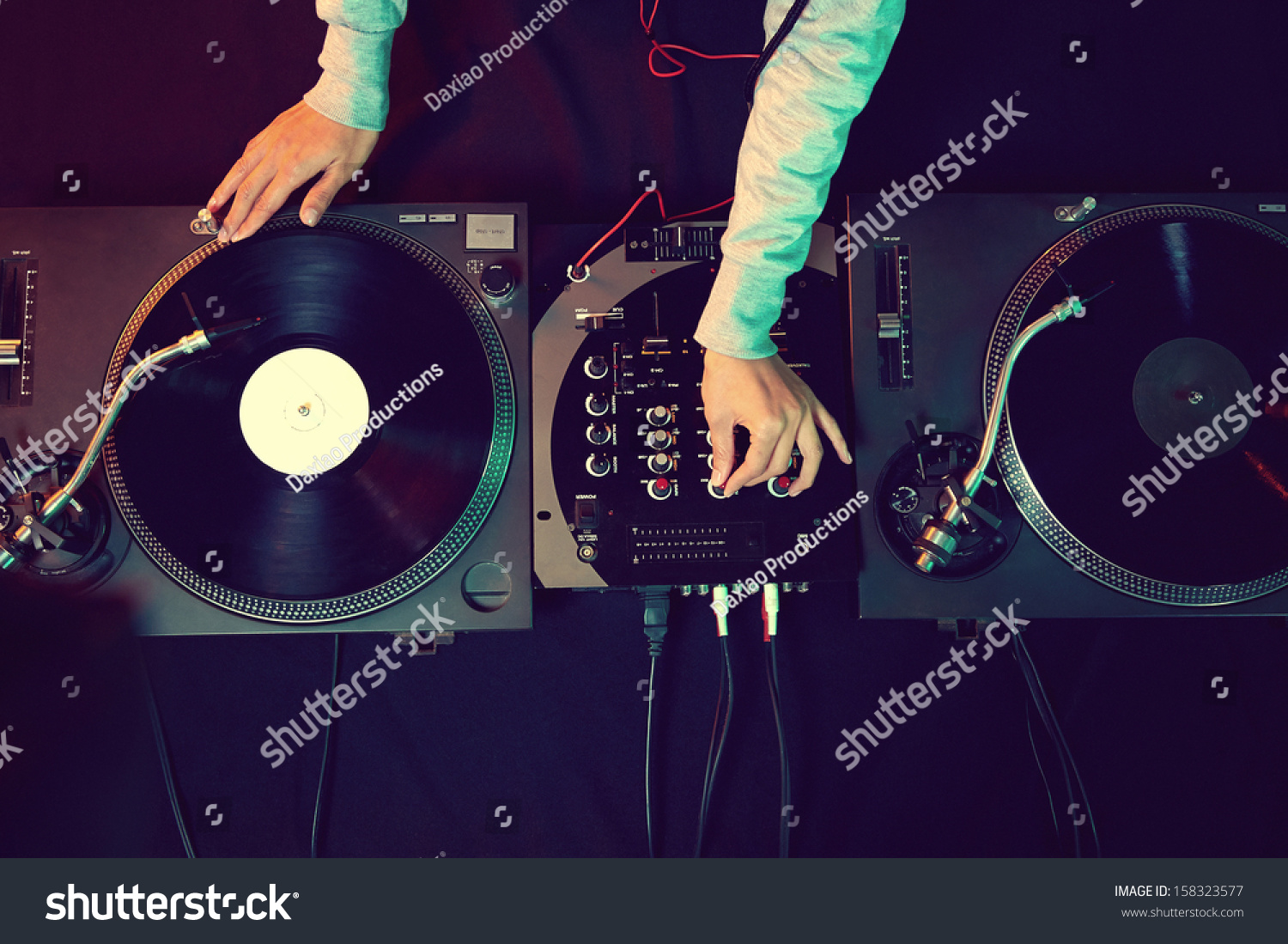 Dj hands on equipment deck and mixer with vinyl record at party #158323577