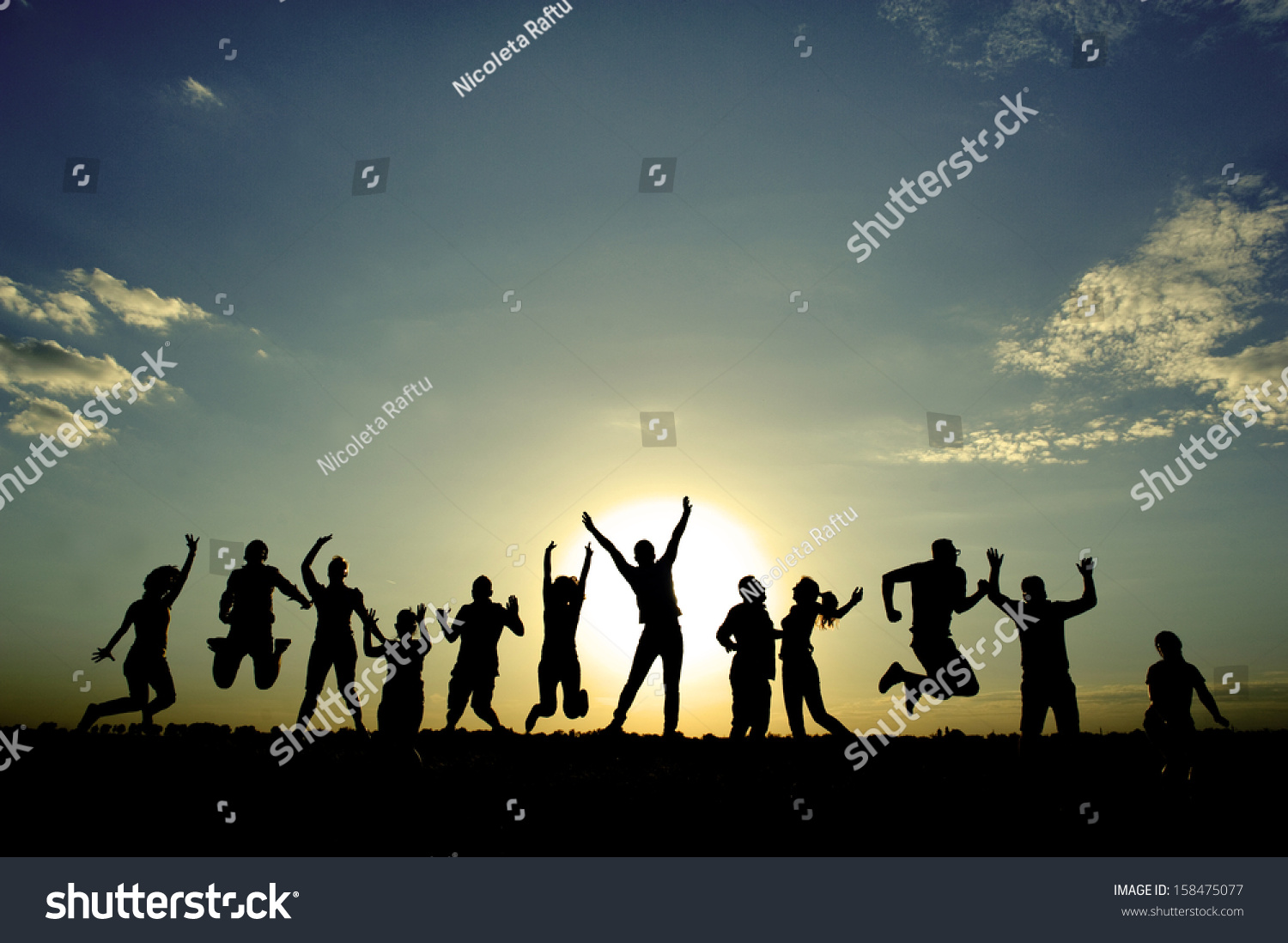 people jumping for joy stock photo 158475077 shutterstock