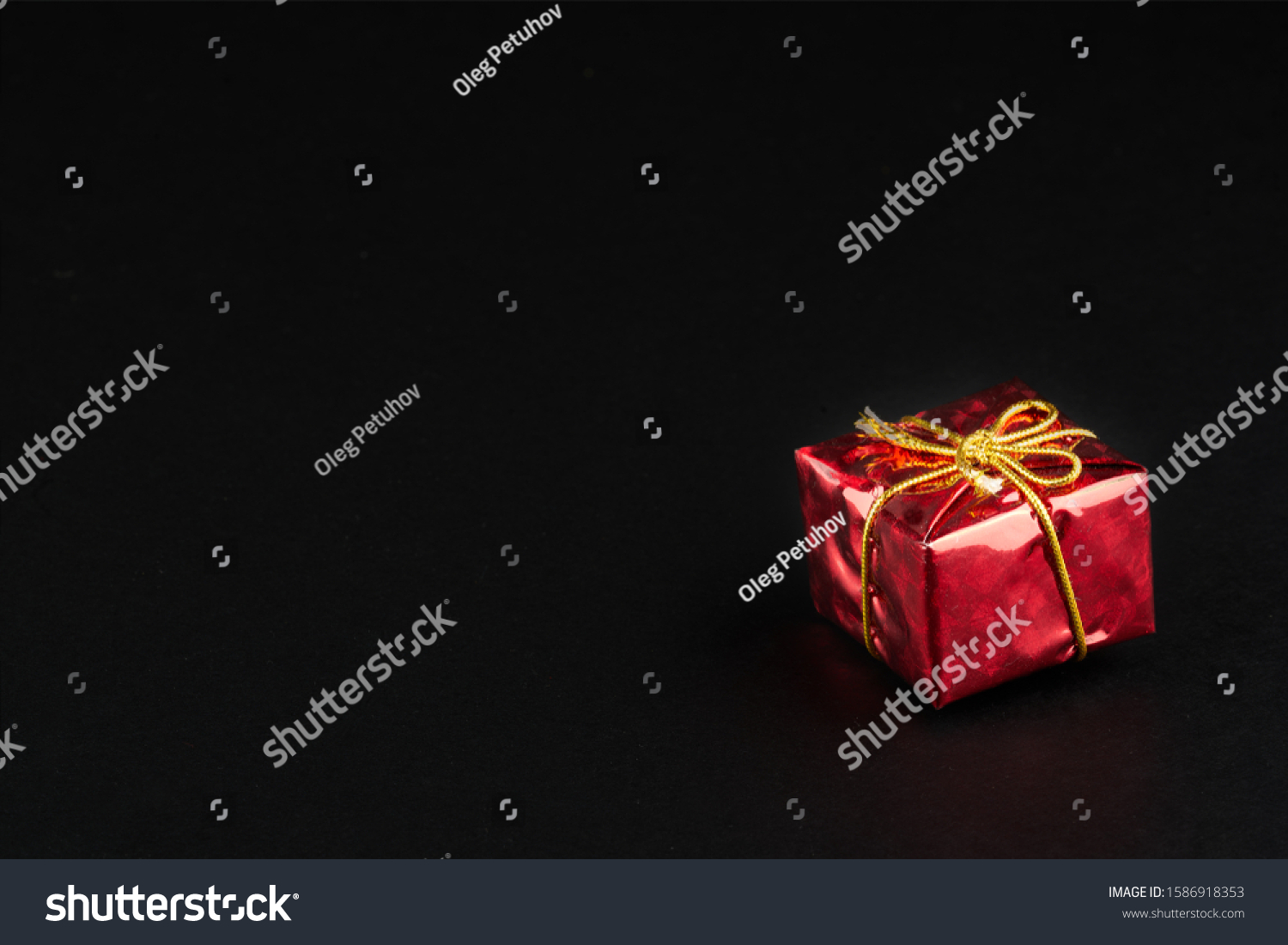 Christmass  tmass gift in red paper isolated at black background #1586918353