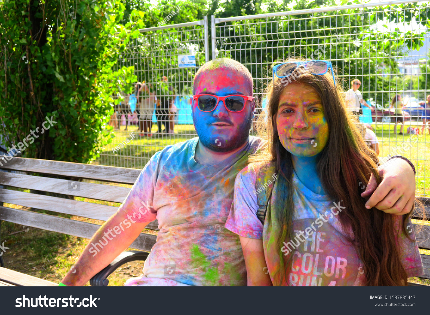 Montreal, Canada - August 2019: A young couple highly colored by colored powder at Montreal's Holi festival