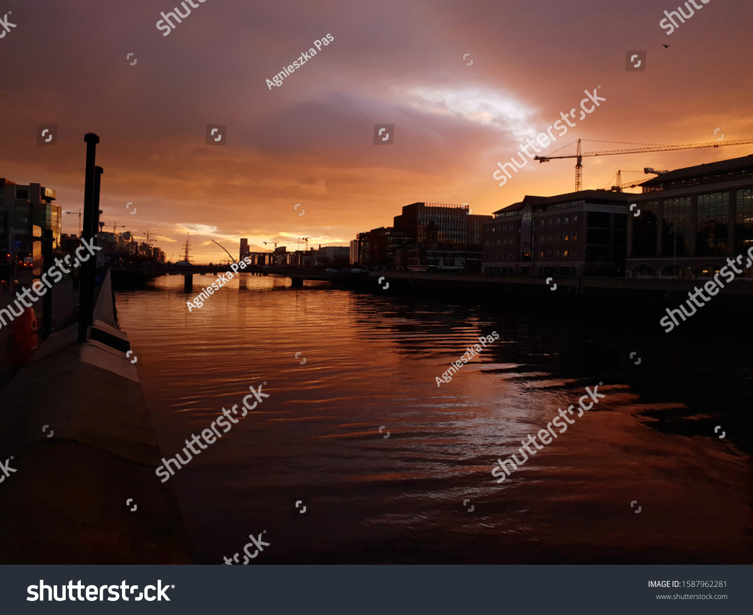 DUBLIN, IRELAND - DECEMBER 4, 2019: Sunrise over the River Liffey in Dublin. View from IFSC area, towards Dublin Port.