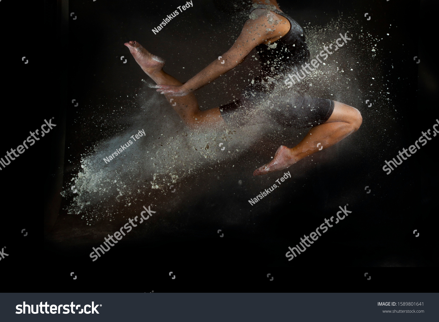 woman do gymnastics movements with splashes of powder  #1589801641