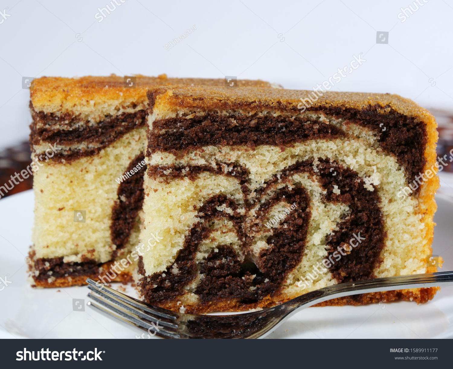 Chocolate marble cake slices on white plate