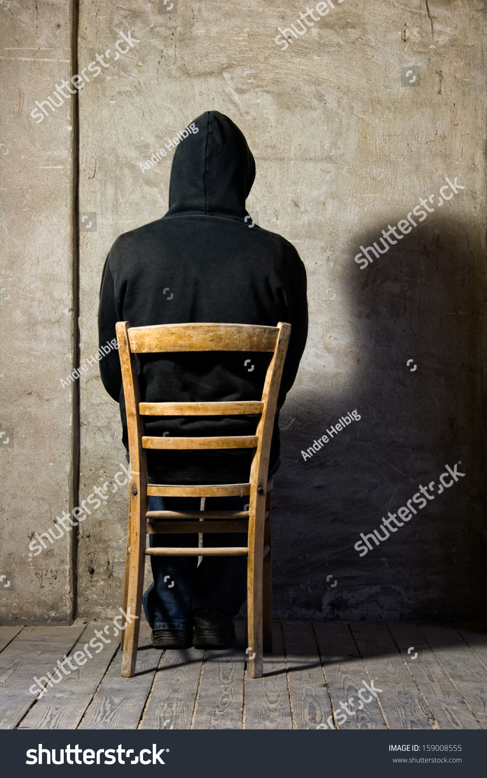 Hooded man sitting