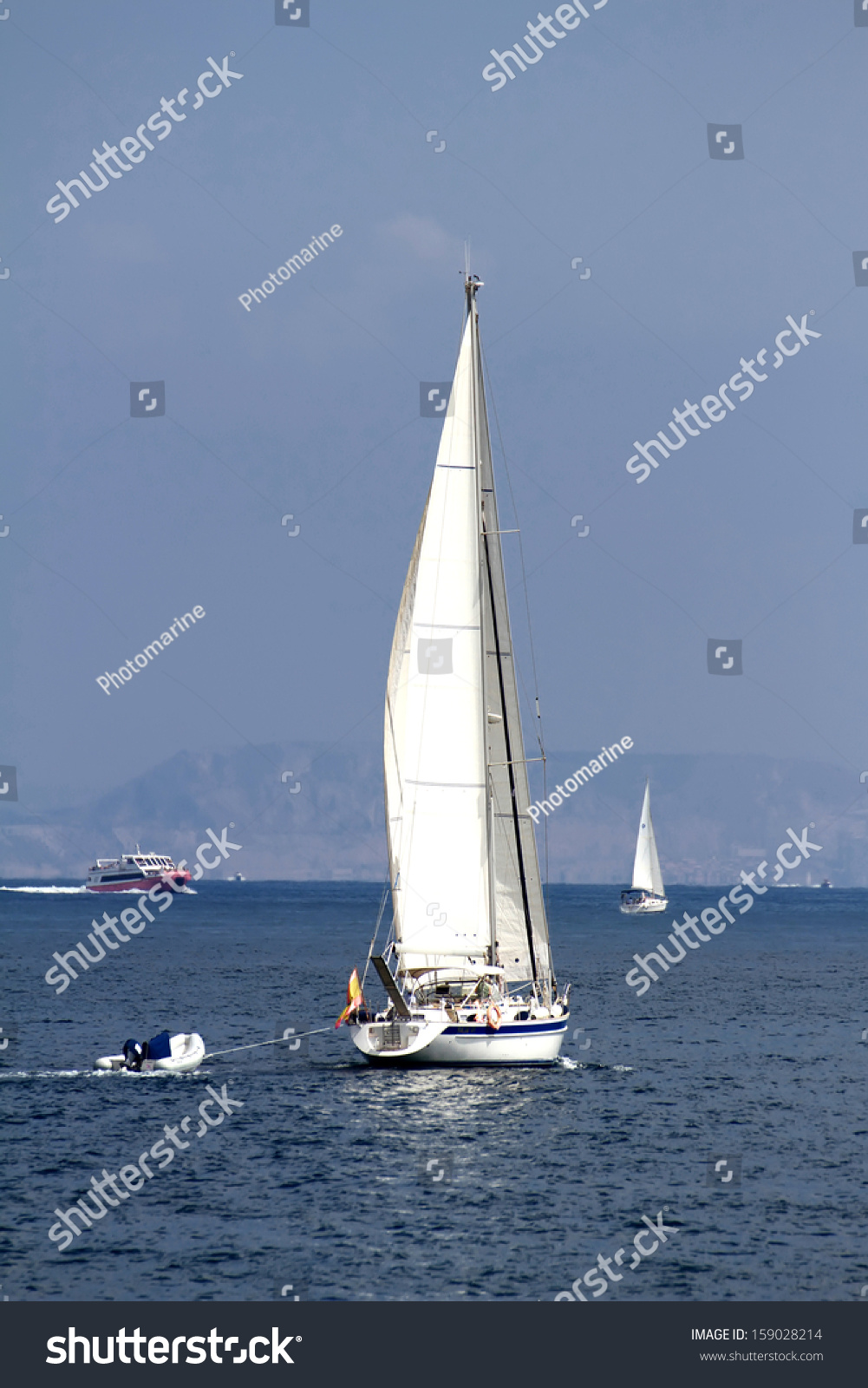 Sailing boat close coast alicante spain stock photo for Z yachting torrevieja