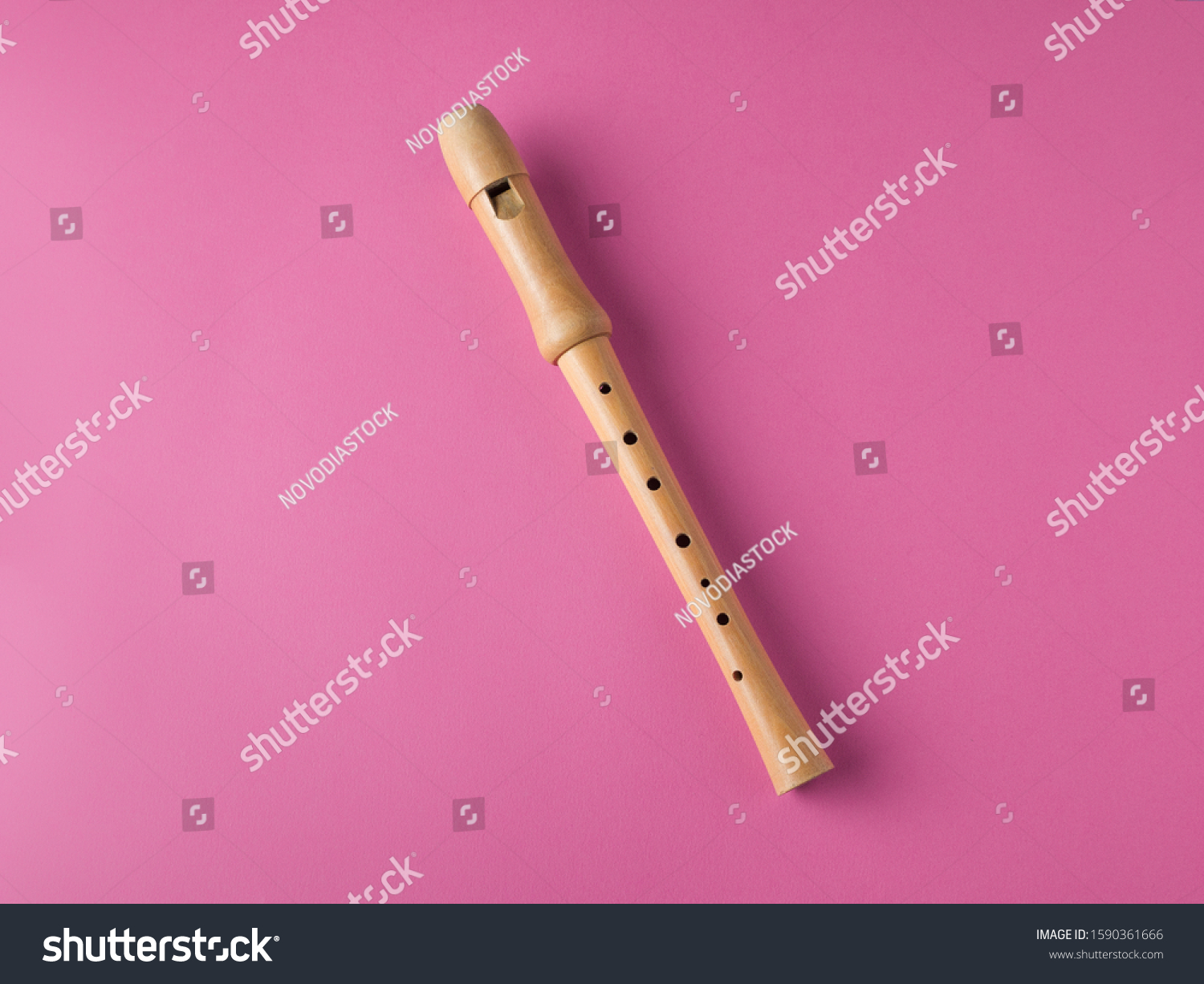 wooden recorder isolated on pink background, with copy space, musical education concept #1590361666