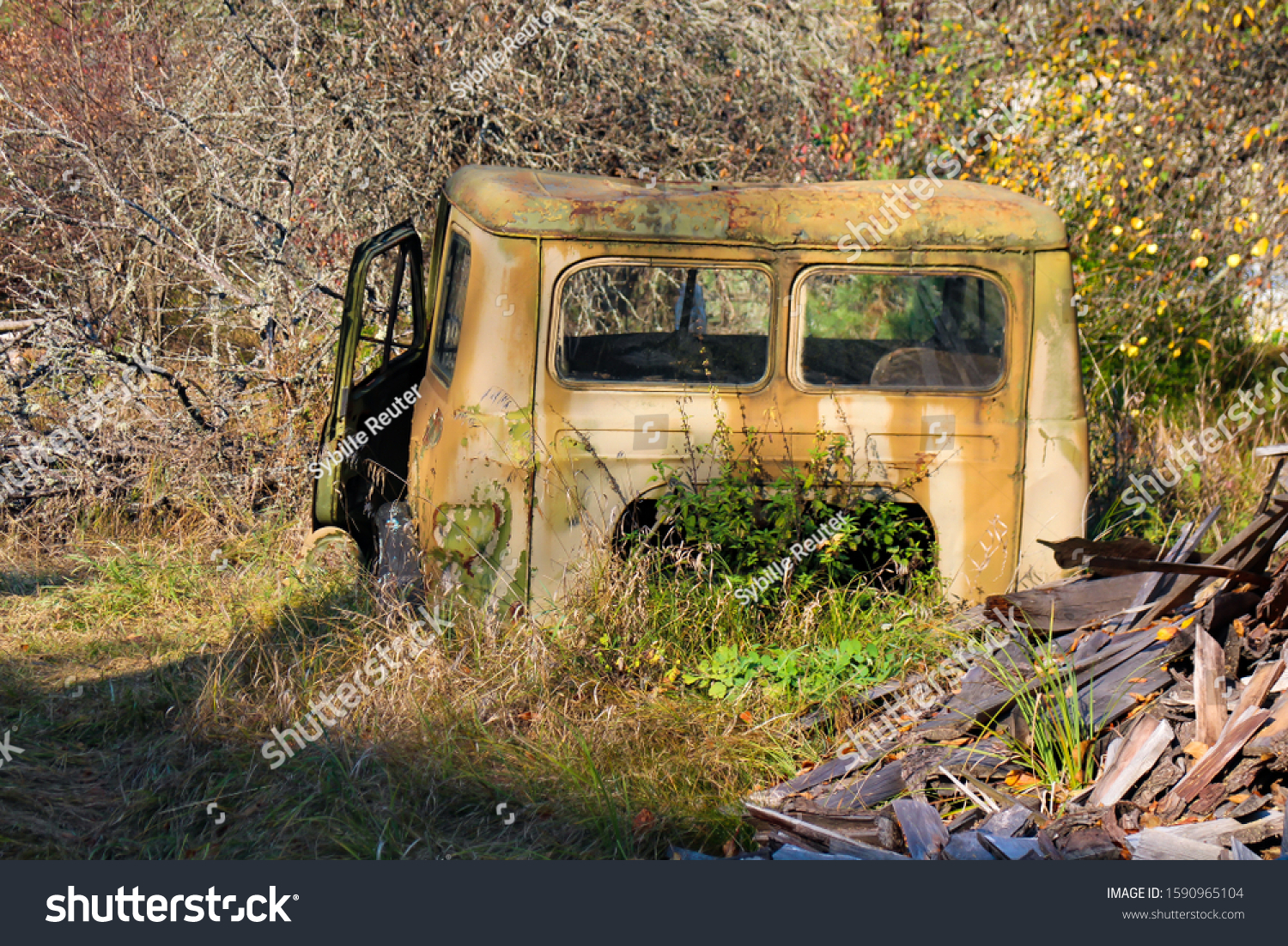 stock-photo-abandoned-rusty-car-wreck-is