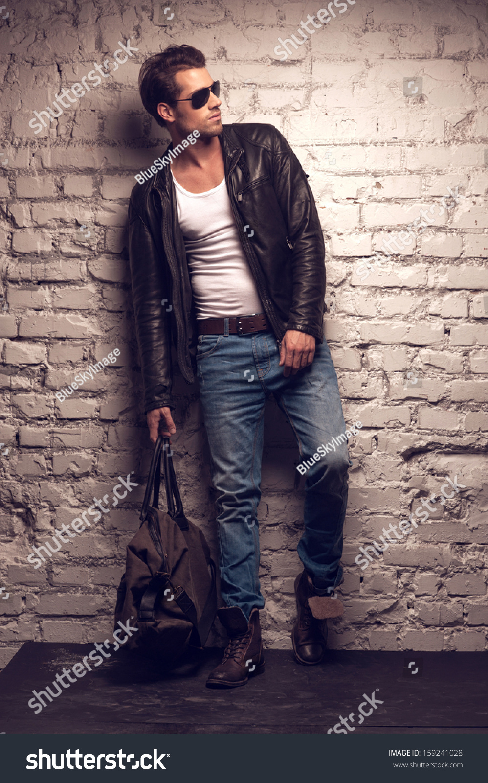 Leather jacket photoshoot - Standing In Black Leather Jacket And Jeans