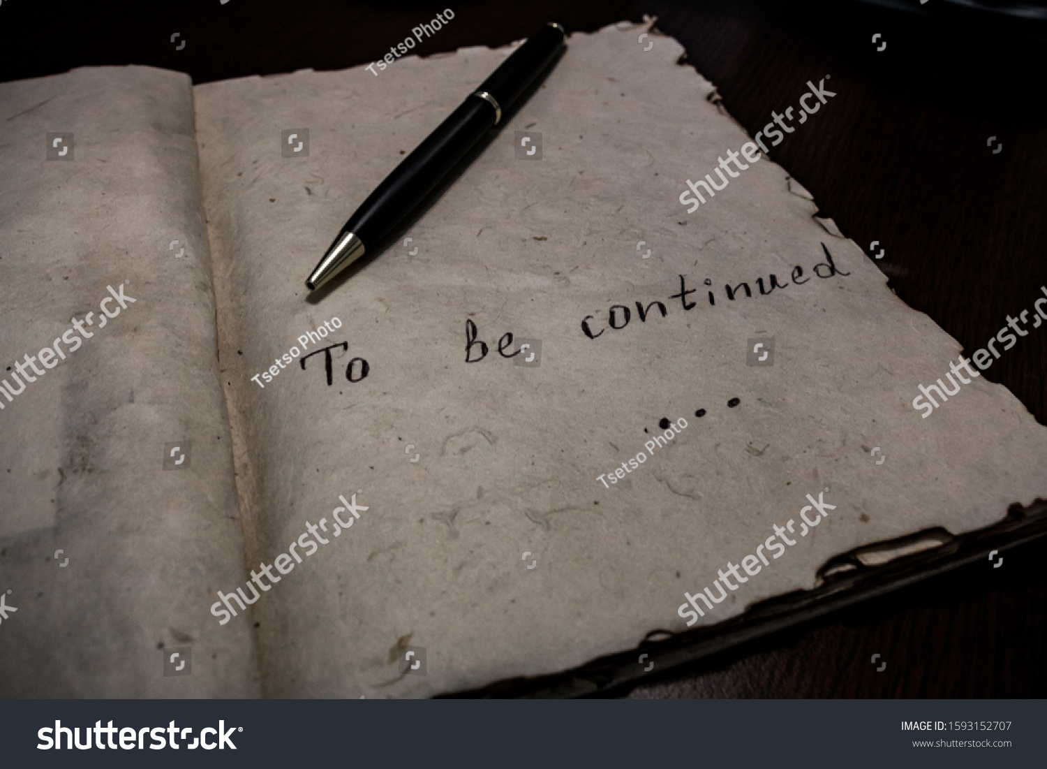 Be continued typed words on vintage old paper #1593152707