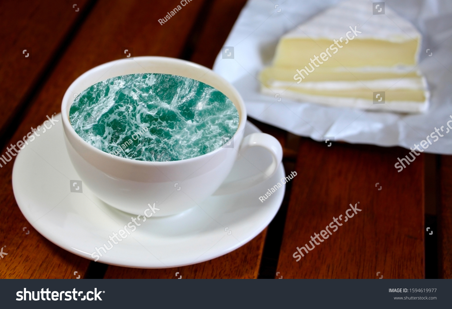 White cup with water. Sea. Ocean. Sea waves. Creative postcard. #1594619977