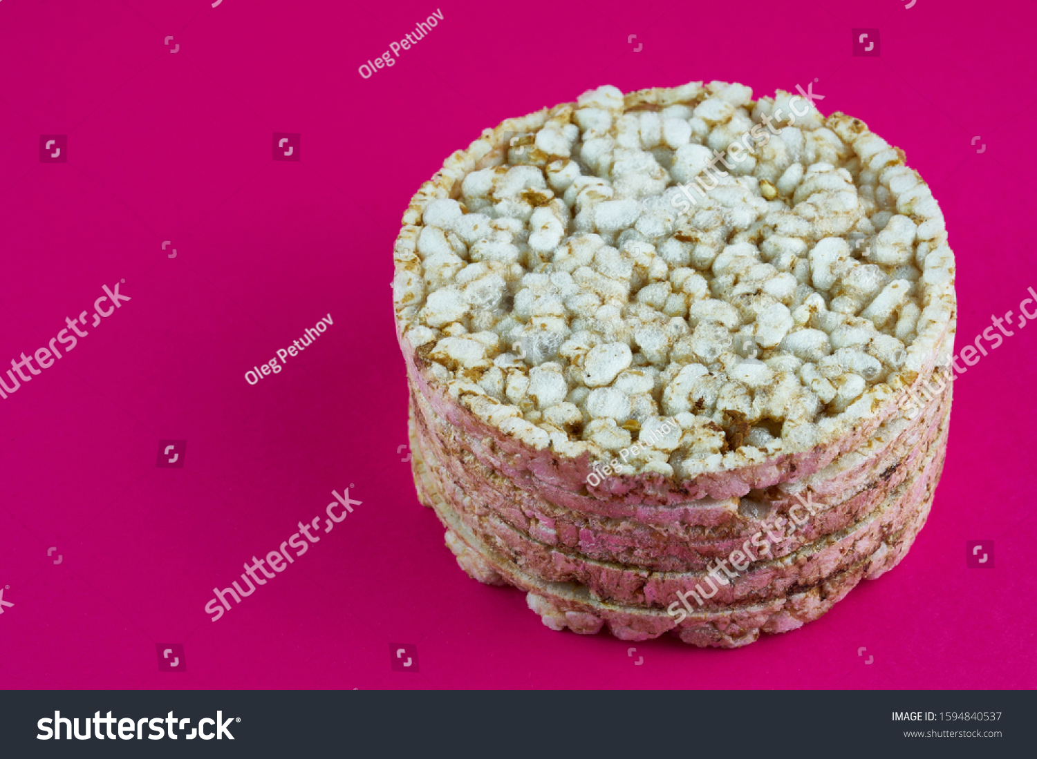 Single rice cake on the red background #1594840537